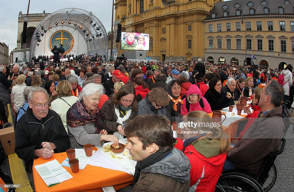 Members of different religious communities celebrate Greek orthodox vespers (artoklasia) during day 3 of the 2nd Ecumenical Church Day (2. Oekumenischer Kirchentag) at Odeonsplatz square on May 14, 2010 in Munich, Germany. Bread, wine and olive oil were served and shared on a thousand tables by invitation of the Munich Greek-orthodox Church, after celebrating the religious service. Thousands will travel to the southern German city to take part in the Church Day events been held from May 12 to May 16, 2010.