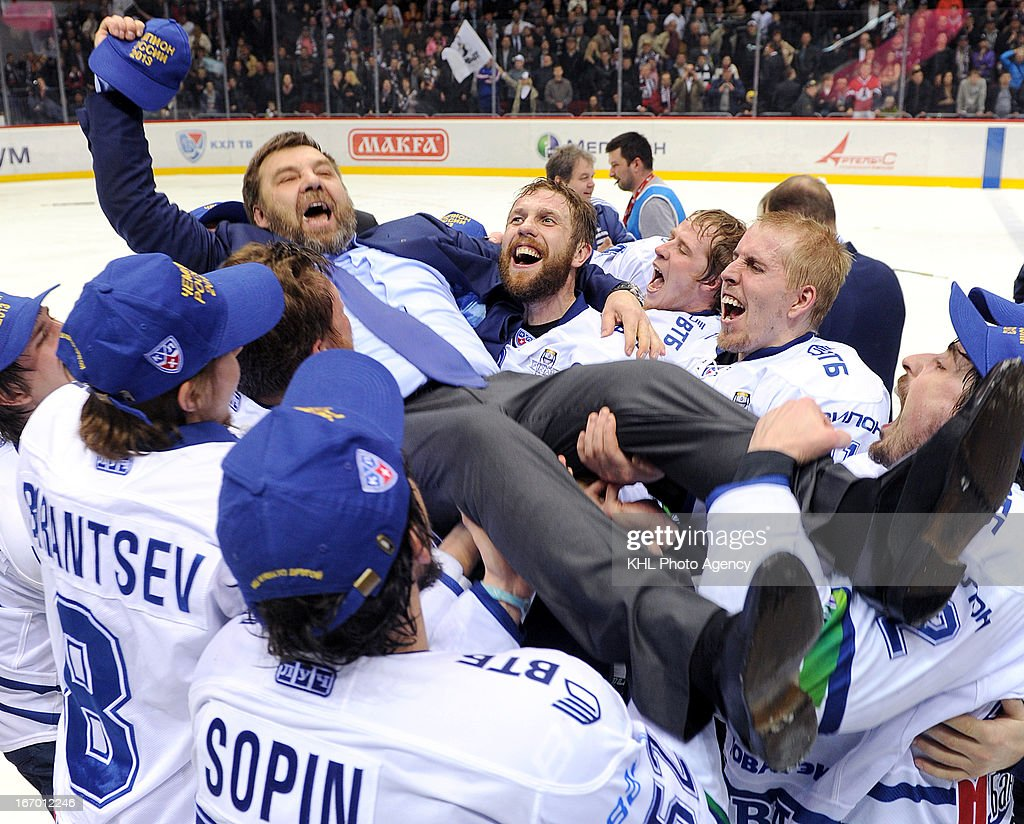 Members of Dinamo celebrate with coach Oleg Znarok after Dinamo Moscow defeats Traktor Chelyabinsk at the final play-off game during the KHL Championship 2012/2013 on April 18, 2013 at the Arena Traktor in Chelyabinsk, Russia.