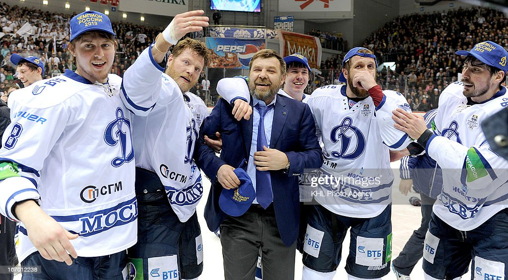 Members of Dinamo Moscow and their coach Oleg Znarok celebrate after defeating Traktor Chelyabinsk at the final play-off game during the KHL Championship 2012/2013 on April 18, 2013 at the Arena Traktor in Chelyabinsk, Russia.