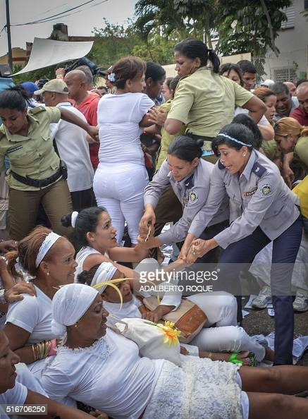 Members of dissident group 'Ladies in White' wives of former political prisoners are detained during their protest on March 20 2016 in Havana...