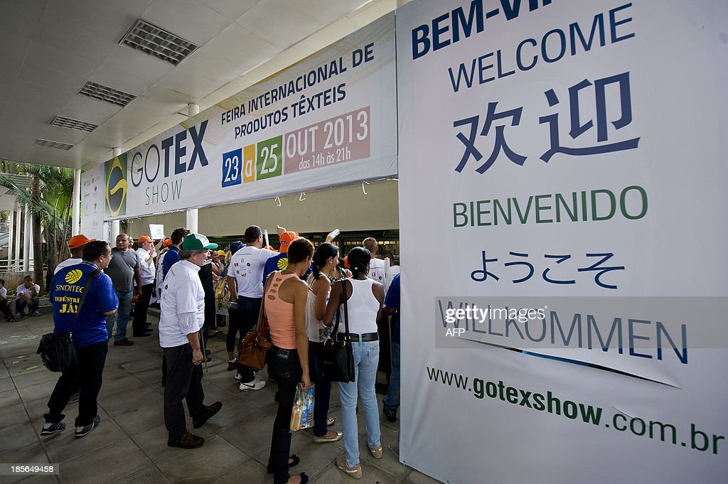 Members of diverse textile unions take part in a demonstration against the opening of an exhibition of Chinese textile industries --Go Tex Show 2013-- in Sao Paulo, Brazil on October 23, 2013. The protestors claim that the Chinese textile imports have been causing unemployment in the sector, and according to the Brazilian Institute of Geography and Statistics (IBGE), about 55,000 workers in the textile industry were dismissed in Brazil in 2013. AFP PHOTO / Nelson ALMEIDA