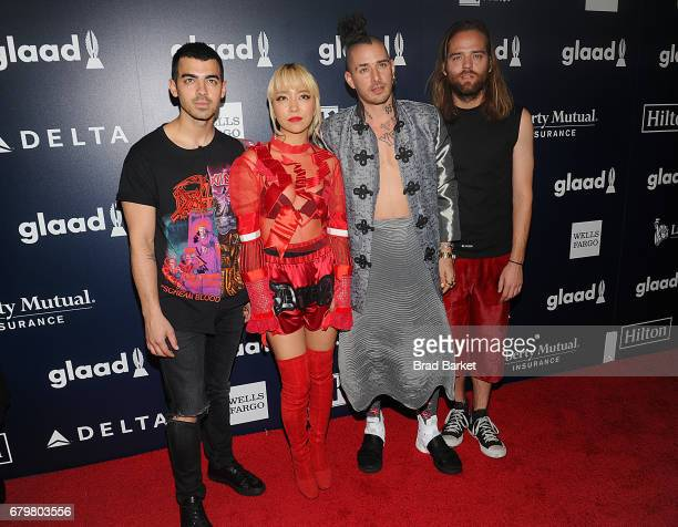 Members of DNCE Joe Jonas JinJoo Lee Cole Whittle and Jack Lawless attend as Ketel One Vodka sponsors the 28th Annual GLAAD Media Awards in New York...