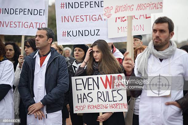 Members of Doctors Without Borders also known by its French name Medecins Sans Frontieres hold placards during a demonstration on November 3 2015 in...