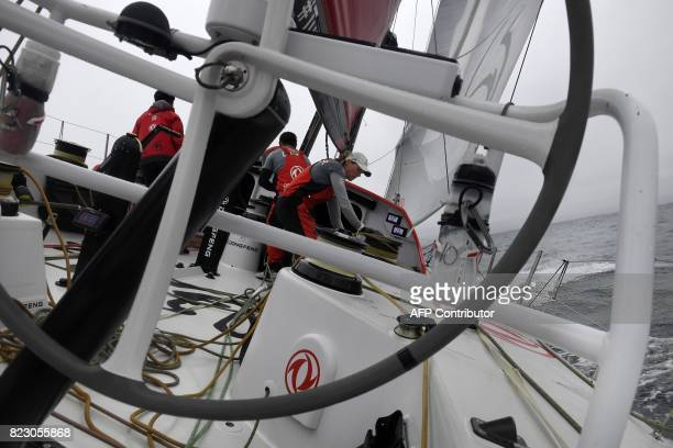 Members of Dongfeng race team sail on July 26 2017 off the coast of Lorient western France as they train for the next Volvo Ocean Race a yacht race...