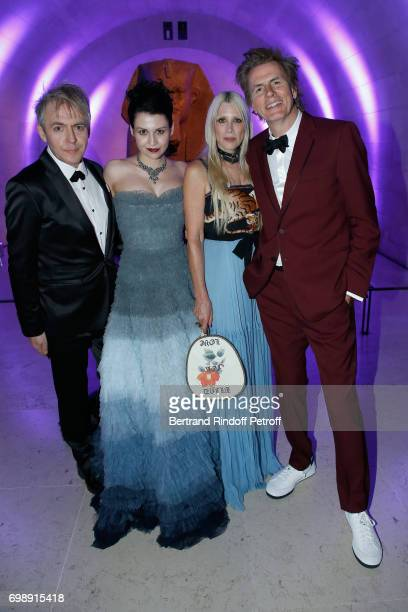 Members of 'Duran Duran' Nick Rhodes his companion Nefer Suvio John Taylor and his wife Gela attend the 'Liaisons au Louvre IV' Evening of patronage...
