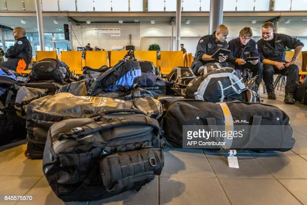 Members of Dutch Urban Search and Rescue wait at Eindhoven Airport on September 11 before their flight to Sint Maarten France the Netherlands and...