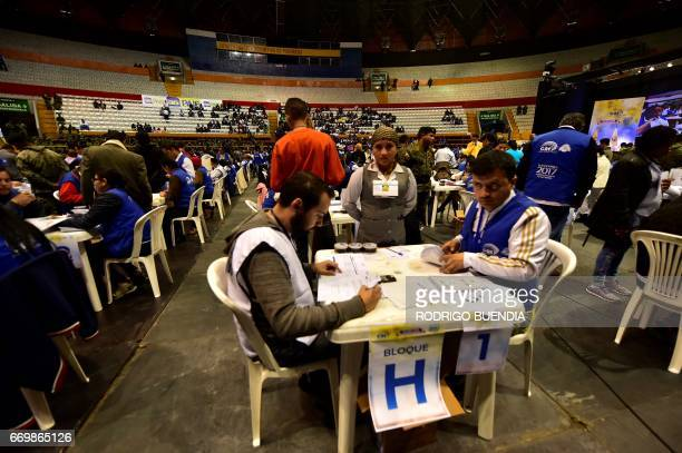 Members of Ecuador's National Electoral Council recount the votes of the April 2 runoff election at the Rumiñahui Coliseum in Quito on April 18 2017...