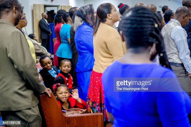 Members of Eglise Baptiste du Calvaire Church during services on Sunday August 13 2017 in Adelphi Maryland Haitian churches in the area are dealing...