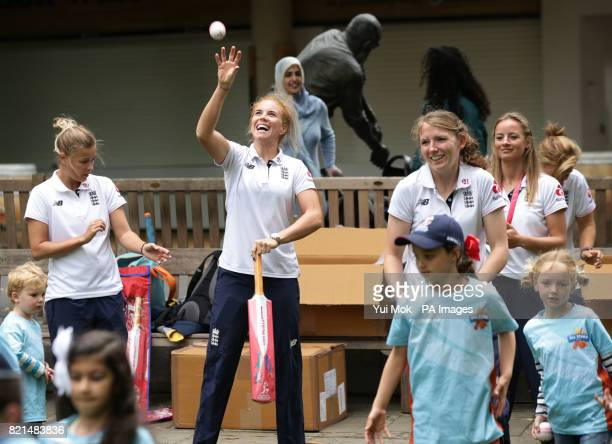 Members of England women's cricket team help children from the All Stars Cricket programme with cricket skills during a media call at Lord's London