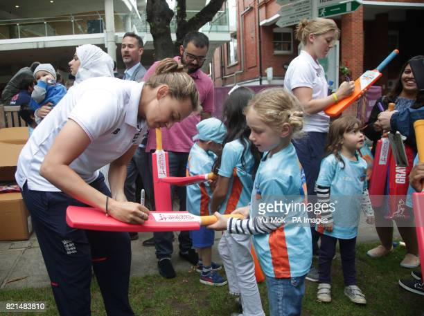 Members of England women's cricket team sign bats for children from the All Stars Cricket programme during a media call at Lord's London