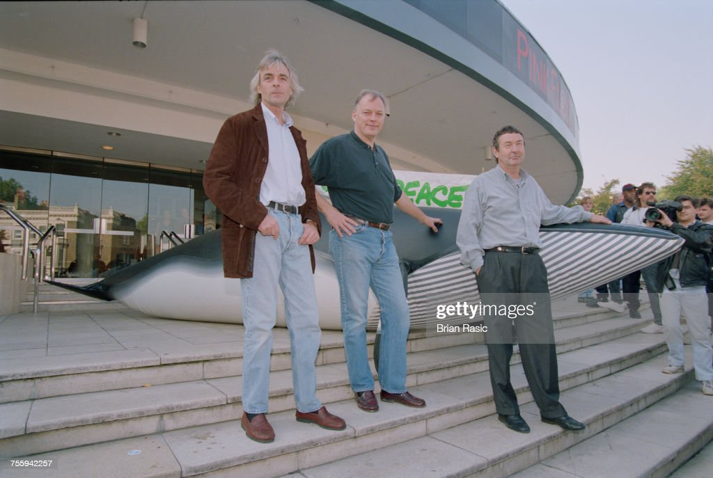 Members of English rock band Pink Floyd, from left, Richard Wright (1943-2008), David Gilmour and Nick Mason posed together with a Greenpeace model Blue Whale on the steps of Earls Court Exhibition Centre in London on 12th October 1994. The group will be performing at the venue on their Division Bell tour.