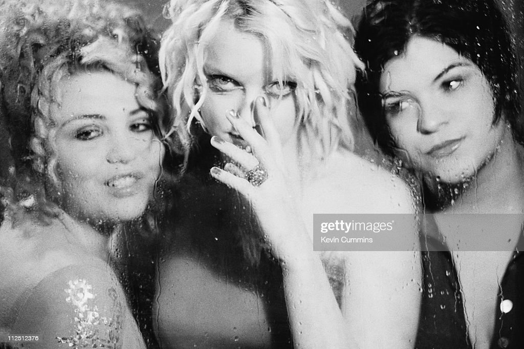 Members of English rock group Kenickie seen through wet glass April 1997 Left to right guitarist Marie du Santiago singer Lauren Laverne and bassist...