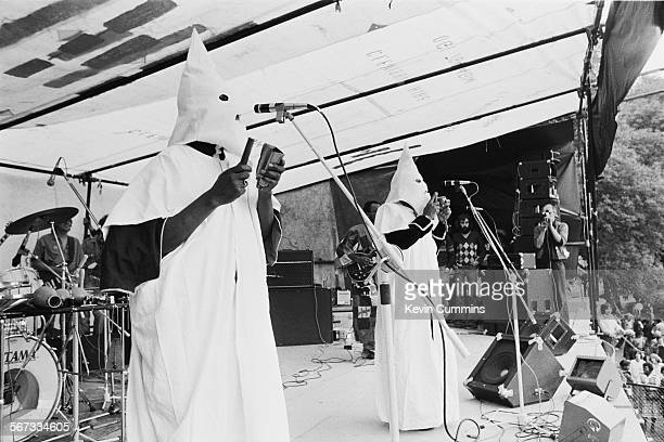 Members of English roots reggae band Steel Pulse performing in Ku Klux Klan hoods at the Northern Rock Against Racism Festival in Alexandra Park...