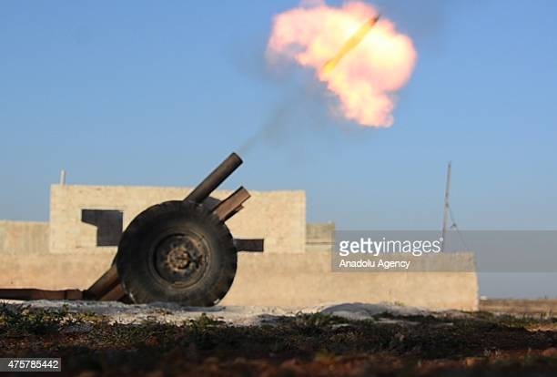 Members of EsSamiyye Front attack Daesh militants near the town of Mari in Aleppo Syria on June 3 2015