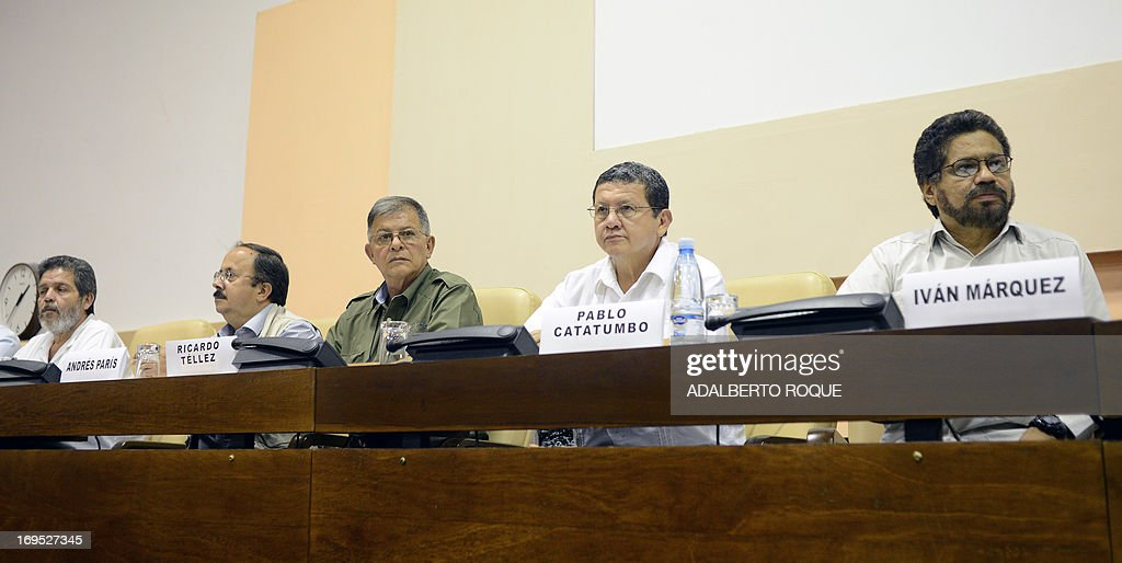 Members of FARC-EP delegation Peace-Talks Commanders (L-R) Marco Leon Calarca, Andres Paris, Ricardo Tellez, Pablo Catatumbo and Ivan Marquezattend a press conference at Convention Palace in Havana, on May 26, 2013 following the announcement that both delegations arrived to an agreement on the first item of a five-point agenda, land reform. Land distribution was one of the triggers of the decades-old conflict in Colombia.