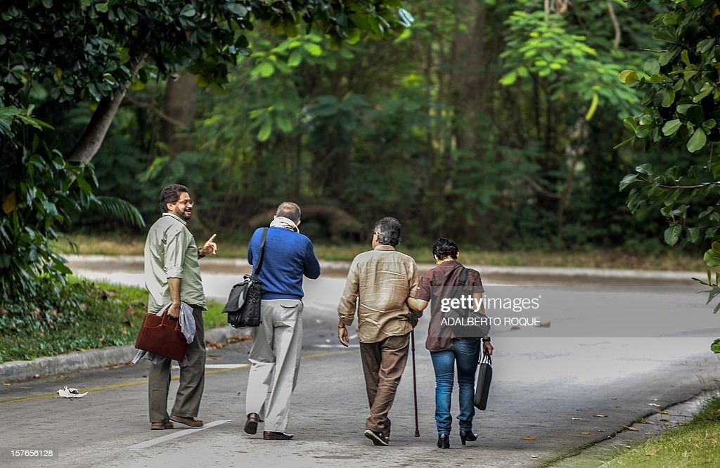 Members of FARC-EP leftist guerrillas delegation arrive at the Convention Palace in Havana for the peace talks with the Colombian government, on December 5, 2012. AFP PHOTO/ADALBERTO ROQUE