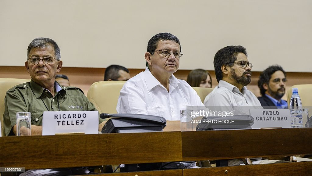 Members of FARC-EP Peace-Talks delegation Commanders Ricardo Tellez, Pablo Catatumbo and Ivan Marquez attend a press conference at Convention Palace in Havana, on May 26, 2013 following the announcement that both delegations arrived to an agreement on the first item of a five-point agenda, land reform. Land distribution was one of the triggers of the decades-old conflict in Colombia.