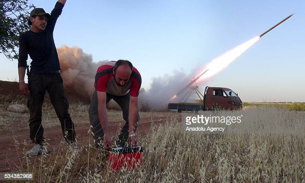 Members of Faylaq alSham a branch of Syrian opposition launch rocket attack to Assad regime forces during the clashes in Hama Syria on May 26 2016