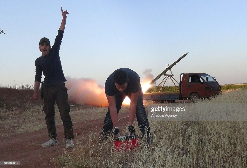 Members of Faylaq al-Sham, a branch of Syrian opposition, launch rocket attack to Assad regime forces during the clashes in Hama, Syria on May 26, 2016.