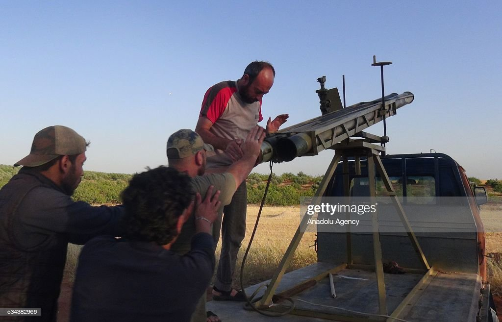 Members of Faylaq al-Sham, a branch of Syrian opposition, prepare to launch rockets to Assad regime forces during the clashes in Hama, Syria on May 26, 2016.