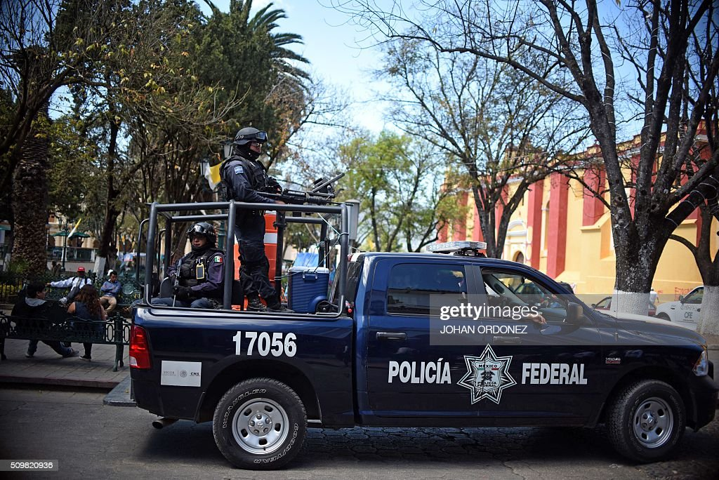 Members of Federal Police patrol the streets of San Cristobal de las Casas, Chiapas State, Mexico on February 12, 2016. Pope Francis will arrive in Mexico on Friday, where he will visit until February 17. AFP PHOTO/Johan ORDONEZ / AFP / JOHAN ORDONEZ