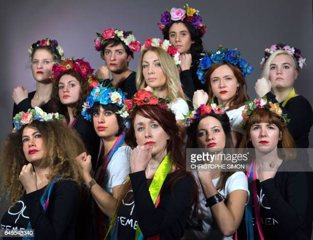 Members of feminist activist group Femen pose on March 5 2017 in Paris Lower row LtoR Fleur Kovacevic Lola Vernot Sophia Antoine Nora Benomar and...