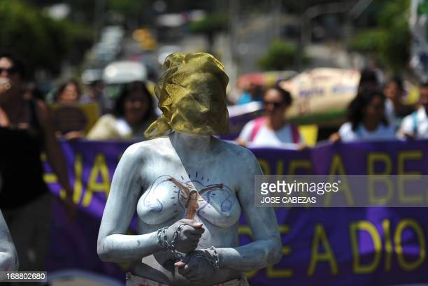Members of feminist organizations demonstrate in favour of abortion outside the Courthouse of San Salvador on May 15 2013 Feminist organizations are...