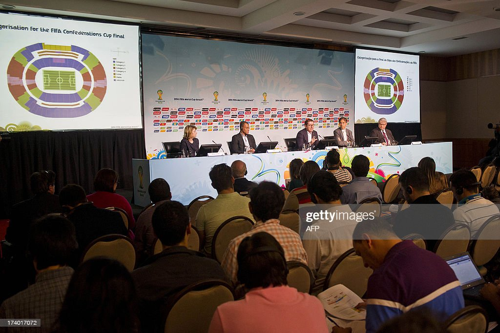 Members of FIFA and the Local Organising Comittee attend a media briefing to announce the ticketing strategy for the 2014 FIFA World Cup on July 19, 2013, in Sao Paulo, Brazil. AFP PHOTO / NELSON ALMEIDA