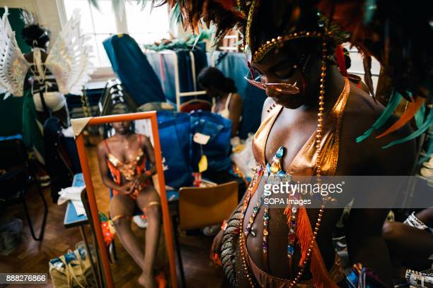 Members of Flagz Mas Band get ready for the second day of Notting Hill Carnival in the hall of a local school The Notting Hill Carnival is a yearly...