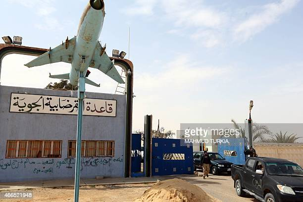 Members of forces loyal to Libya's Islamistbacked parliament General National Congress secure the AlGhardabiya airbase as they fight Islamic State...