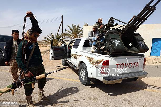Members of forces loyal to Libya's Islamistbacked parliament General National Congress prepare to launch attacks as they continue to fight Islamic...