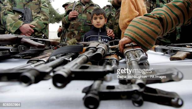 Members of former warlord General Rashid Dostum's militia hand over some of their arsenal to the Afghan National Army in Sherberghan northern...