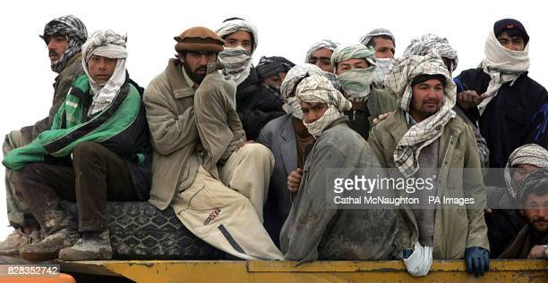Members of former warlord General Rashid Dostum's militia on board a vehicle after handing over some of their arsenal to the Afghan National Army in...