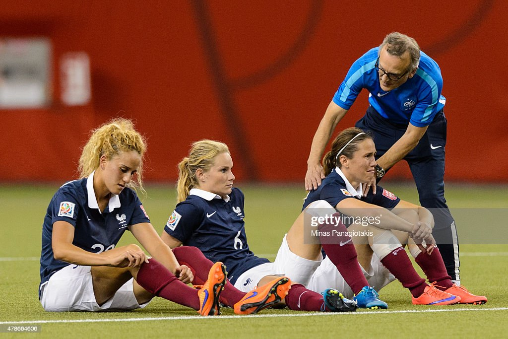 Members of France look on as Germany celebrates their victory during the 2015 FIFA Women's World Cup quarter final match at Olympic Stadium on June 26, 2015 in Montreal, Quebec, Canada. Germany defeated France 5-4 on penalty kicks and move to the semifinal round.