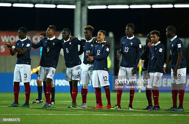 Members of France react after teammate Timothe Cognat missed his penalty kick during the penalty kick shootout against Costa Rica the France v Costa...