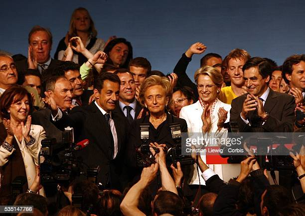 Members of France's Union for a Popular Movement political party gather around presidential hopeful Nicolas Sarkozy at a campaign rally in...
