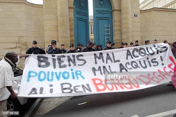 Members of 'Free Gabon collective' and French collective Jeudi Noir which squats unoccupied building to protest against the realestate speculation...