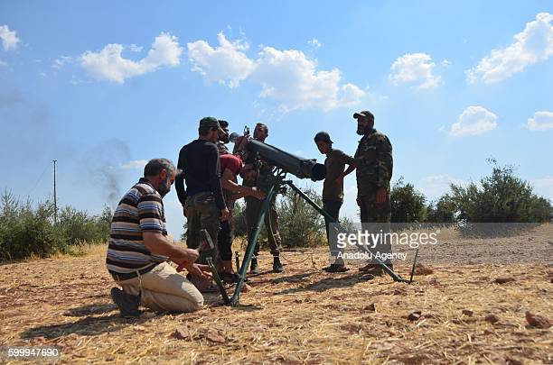 Members of Free Syrian Army are seen as they make preparations before they attack with missiles to Hatam Military Barracks of Assad Regime forces in...