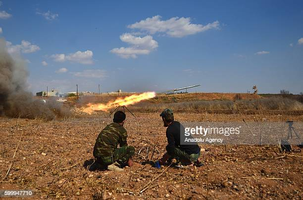 Members of Free Syrian Army attack with missiles to Hatam Military Barracks of Assad Regime forces in Hama Syria on September 7 2016