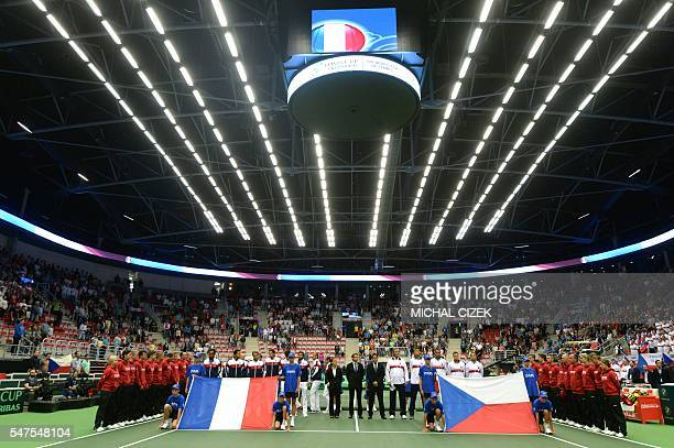 Members of French and Czech Davis Cup teams observe a minute of silence for the victims of the terror attack in Nice during the International Tennis...
