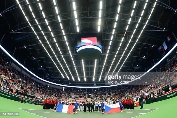 TOPSHOT Members of French and Czech Davis Cup teams observe a minute of silence for the victims of the terror attack in Nice during the International...