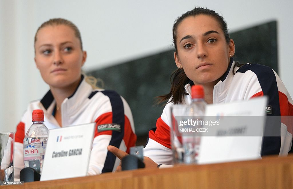 Members of French Fed Cup Team Kristina Mladenovic (l) and Caroline Garcia attend the International Tennis Federation Fed Cup final draw ceremony on April 17, 2015 in Ostrava. The Fed Cup semi-final, Czech Republic against France, is scheduled on April 18-19, 2015.