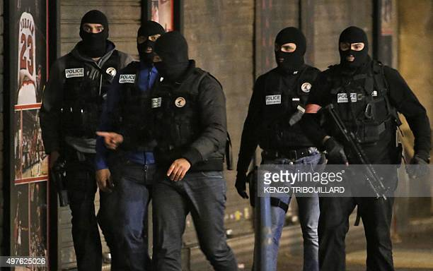 Members of French police special forces in the northern Paris suburb of SaintDenis city center on November 18 as French Police special forces raid an...