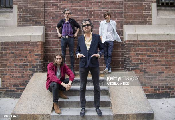 Members of French rock band Phoenix Deck d'Arcy Laurent Brancowitz Christian Mazzalai and Thomas Mars pose for a picture after an interview with AFP...