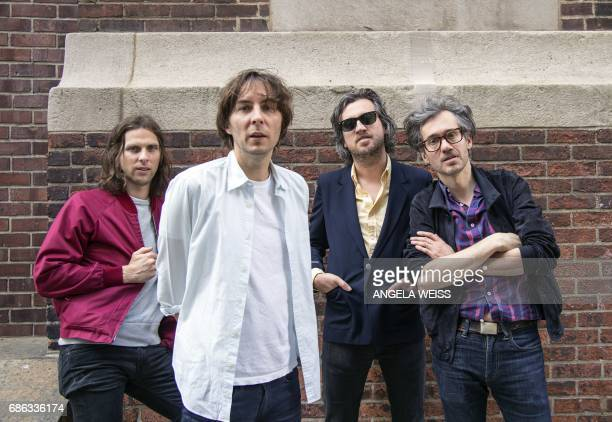 Members of French rock band Phoenix Deck d'Arcy Thomas Mars Christian Mazzalai and Laurent Brancowitz pose for a picture after an interview with AFP...