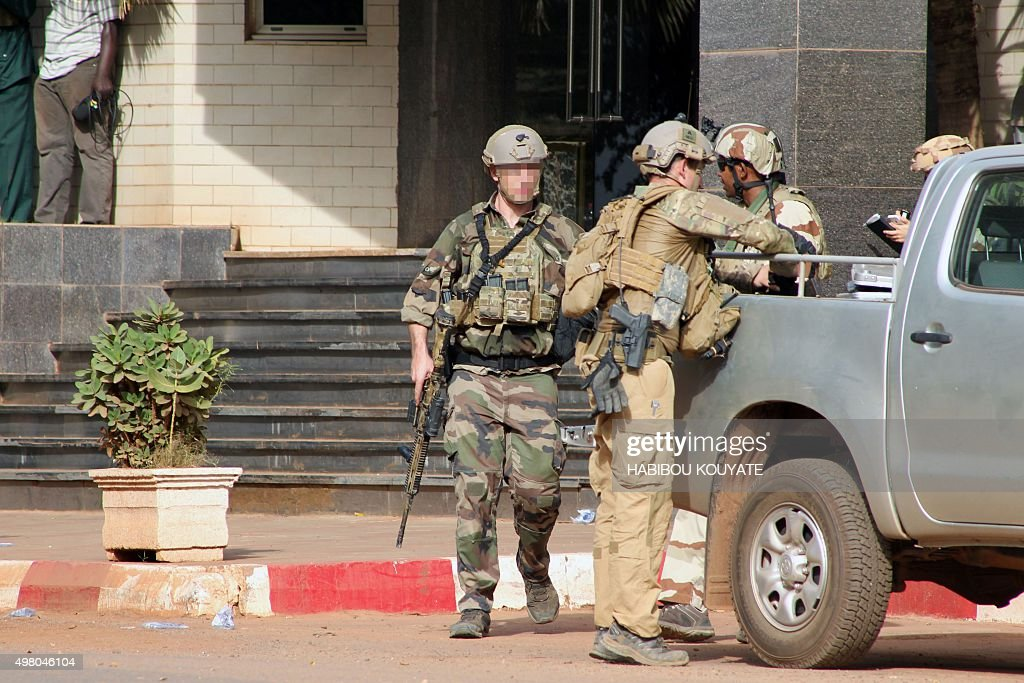 Members of French special forces stand guard in front of the entrance of the Radisson Blu hotel in Bamako on November 20 after the assault of...