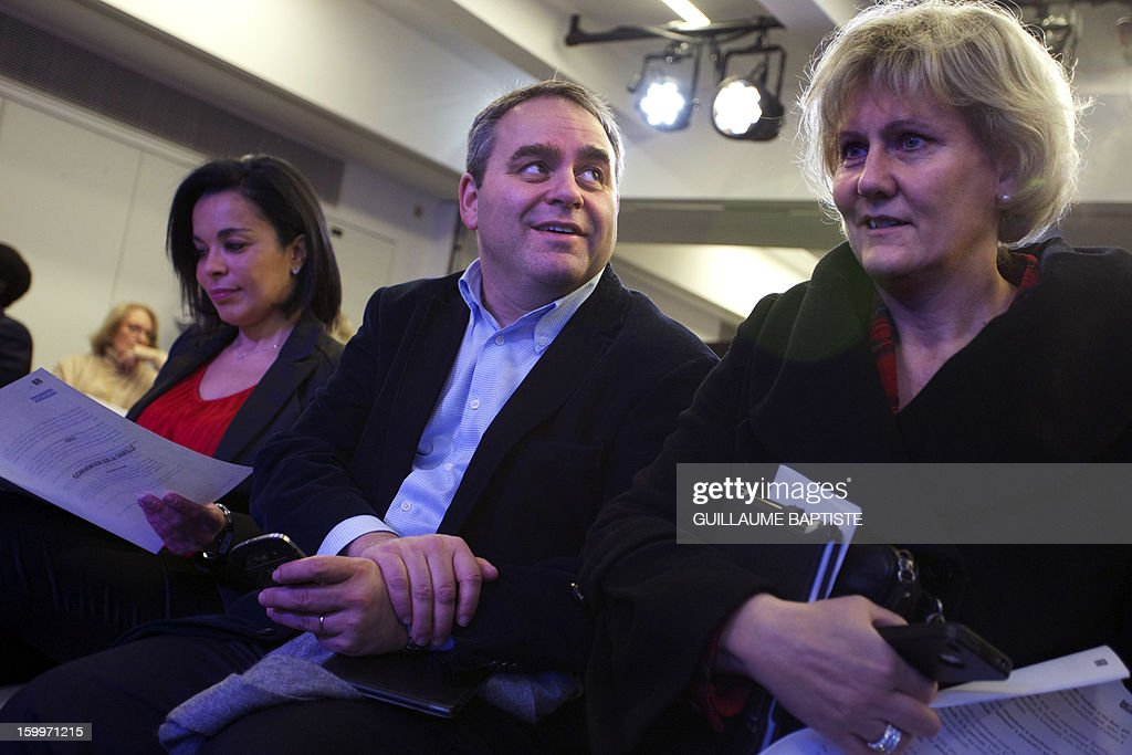 Members of French UMP opposition right-wing party (LtoR) Salima Saa, Xavier Bertrand and Nadine Morano listen to speeches, on January 24, 2013 at the party headquarters in Paris, as they take part in a convention focused on family matters.