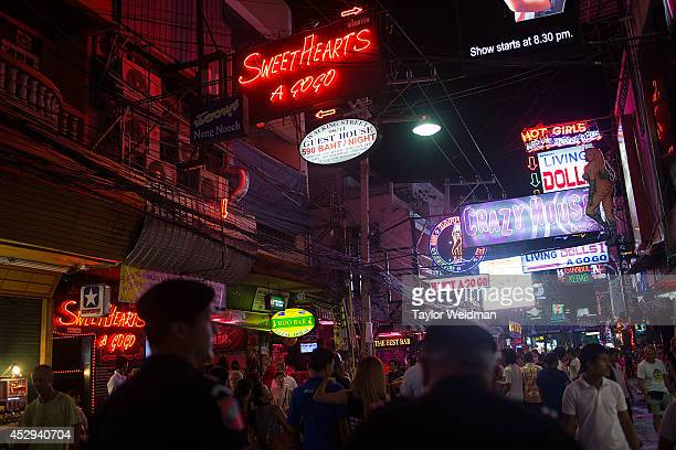 Members of FTPA patrol Pattaya's Walking Street on July 30 2014 in Pattaya Thailand Since 2002 members of the Foreign Tourist Police Assistants of...