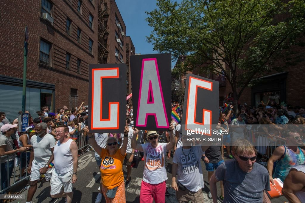 Members of Gays Against Guns (GAG) march during the 46th annual Gay Pride march June 26, 2016 in New York. New York kicked off June 26 what organizers hope will be the city's largest ever Gay Pride march, honoring the 49 people killed in the Orlando nightclub massacre and celebrate tolerance. / AFP / the 46th / Bryan R. Smith
