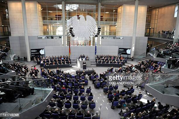 Members of German Parliament and government listen to German new president Joachim Gauck delivering a speech during his swearingin ceremony at the...